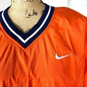 Nike pullover orange and blue wind breaker jacket.